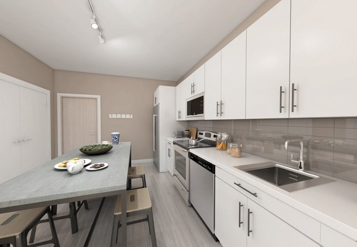 Kitchen with appliances and dining table