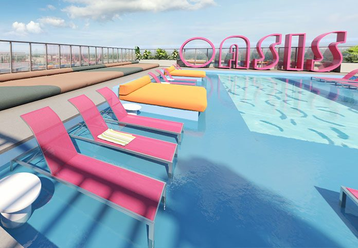 Rooftop pool with in-water deck chairs